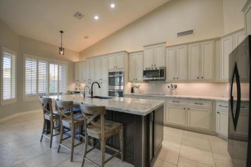 White Cabinets with dark drawer pulls and knobs