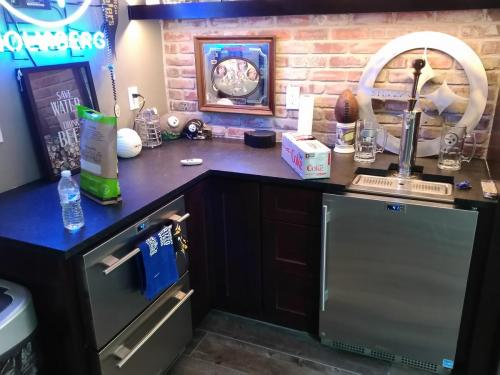 Project- Bar Dark Cabinets & Stainless Steel Appliances